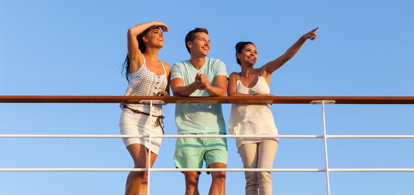 Kids on rail of ship