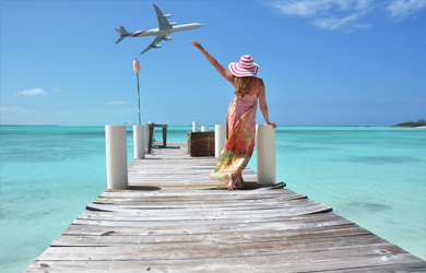 Woman on dock waving at airplane